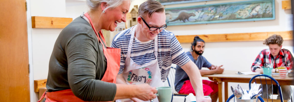 youth with disabilities works along coworker serving at coffee shop