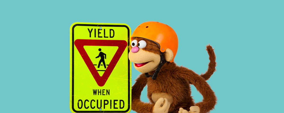 "english as a second language learning website babble tree and its mascot ""beto"" next to a yield sign"