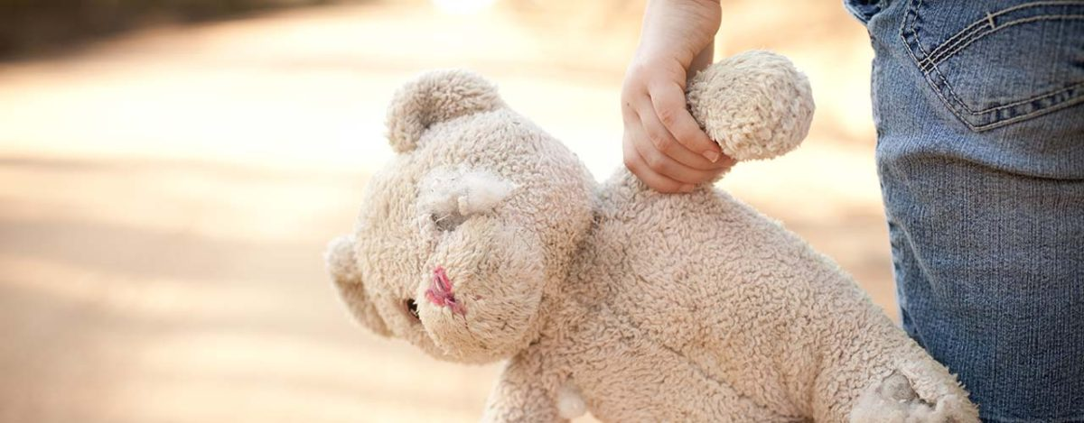 child services child carries teddy damaged teddy bear