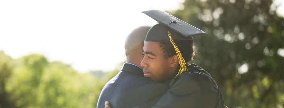 son college student hugs proud dad